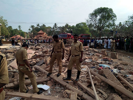Police at Puttingal temple near Paravoor following the fireworks accident on April 10, 2016